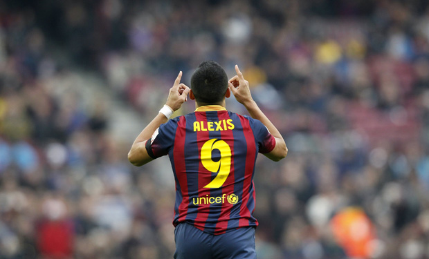 Barcelona's Alexis Sanchez celebrates a goal against Valencia during their Spanish first division soccer match at Camp Nou stadium in Barcelona