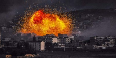 TOPSHOTSSmoke and flames rise following an explosion in the Syrian